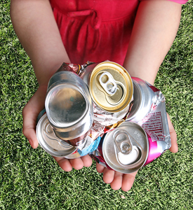 Cans Collector holding cans for recycling