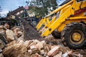 http://www.dreamstime.com/stock-photography-bulldozer-loading-demolition-debris-concrete-waste-recycling-construction-site-image45874532
